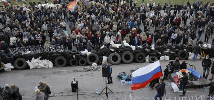 Pro-Russian protesters gather outside a regional government building in Donetsk